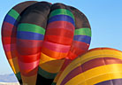 Inflating balloons display striking color and form.